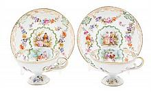 A Pair of Royal Vienna Style Cabinet Cups and Saucers Diameter of saucers 4 1/2 inches.