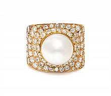 * An 18 Karat Yellow Gold, Cultured South Sea Pearl and Diamond Ring, 17.80 dwts.