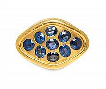 * An 18 Karat Yellow Gold and Sapphire Ring, 14.80 dwts.