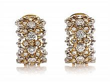 * A Pair of 18 Karat Two Tone Gold and Diamond Earclips, 6.90 dwts.