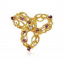 An 18 Karat Yellow Gold, Ruby and Diamond Brooch, Tiffany & Co., Circa 1960, 9.70 dwts.