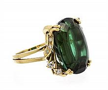 An 18 Karat Yellow Gold, Green Tourmaline and Diamond Ring, 7.30 dwts.