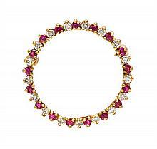 An 18 Karat Yellow Gold, Ruby and Diamond Circle Pendant/Brooch, 2.80 dwts.