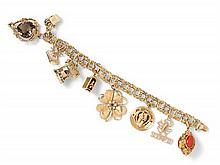 * A 14 Karat Yellow Gold Charm Bracelet with 8 Attached Charms, 36.20 dwts.