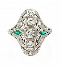 An 18 Karat White Gold, Diamond and Synthetic Emerald Ring, 3.20 dwts.