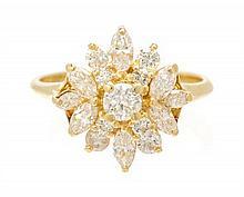 * An 18 Karat Yellow Gold and Diamond Ring, 2.80 dwts.