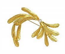 * An 18 Karat Yellow Gold and Diamond Feather Motif Brooch, 8.10 dwts.