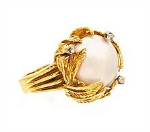 An 18 Karat Yellow Gold, Mabe Pearl and Diamond Leaf Motif Ring, 8.70 dwts.
