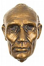 (LINCOLN, ABRAHAM) LIFE MASK. Gesso and bronze gilt plaster life mask, after the original by Leonard Volk.