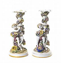 * A Pair of German Porcelain Candlesticks, Height 13 7/8 inches.