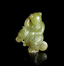 A Carved Yellow Jade Toggle, Height 1 7/8 inches.