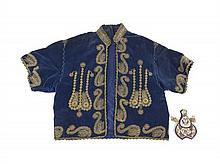 A Chinese Velvet Child's Short Sleeve Jacket, Width of jacket 27 inches.