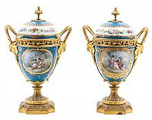 * A Pair of Sevres Style Gilt Bronze Mounted Porcelain Urns Height 11 inches.