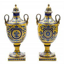 * A Pair of Sevres Style Porcelain Urns Height 11 1/2 inches.