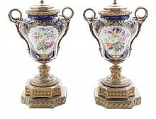 A Pair of Sevres Style Gilt Bronze Mounted Urns Height overall 26 1/2 inches.