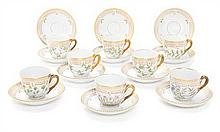 Eight Royal Copenhagen Flora Danica Small Cups and Saucers Diameter of saucer 5 inches.