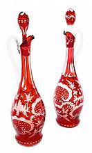 A Pair of Bohemian Red Cut to Clear Glass Decanters Height 14 1/4 inches.