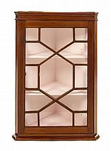 A George III Mahogany Hanging Corner Cupboard Height 37 x width 25 1/2 x depth 14 5/8 inches.