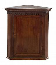 A Chippendale Style Mahogany Hanging Corner Cupboard Height 39 x width 36 1/4 x depth 22 inches.