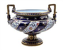 * A Sarreguemines Ceramic Urn Height 11 3/4 x width over handles 14 3/4 inches.