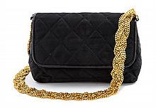 * A Chanel Black Satin Quilted Bag, 7 1/2 x 4 1/2 x 2 1/2 inches.