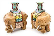 A Pair of Polychrome Porcelain Figural Vases Height 12 3/4 inches.
