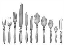 A Danish Silver Flatware Service, Georg Jensen Silversmithy, Copenhagen, Late 20th Century, Cactus pattern, comprising: 16 dinner knive