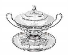 A Victorian Silver Tureen, Cover, and Stand, Barnard Bros., London, 1877/79, the oval tureen with applied guilloche band enclosing flow