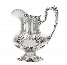 An American Silver Water Pitcher, Reed & Barton, Taunton, MA, 1952, Francis I pattern, of oval baluster form, the sides chased with scr