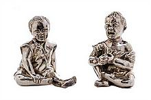 A Pair of Victorian Silver Figural Condiment Containers, Thomas Johnston II, London, 1886, each in the form of a seated child, one laug