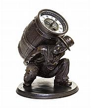 A Patinated Cast Metal Figural Clock Height 8 3/4 inches.