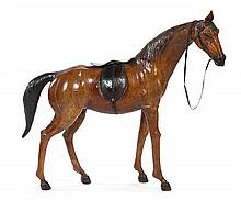 * A Tooled and Painted Leather Model of a Horse Height 37 inches.