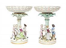A Pair of Meissen Porcelain Figural Compotes Height 12 1/2 x width 9 1/2 inches.