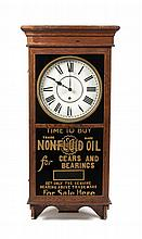 * An American Oak and Reverse Painted Advertising Wall Clock Height 38 x width 16 1/2 x depth 4 1/2 inches.