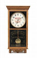 * An American Oak Advertising Wall Clock Height 38 x width 18 x depth 4 1/2 inches.