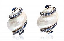 * A Pair of 18 Karat White Gold, Shell, and Sapphire Earclips, Seaman Schepps, 30.70 dwts.