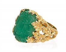 * An 18 Karat Yellow Gold and Carved Emerald Ring, 6.70 dwts.