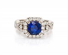 An 18 Karat White Gold, Sapphire and Diamond Ring, 5.50 dwts.