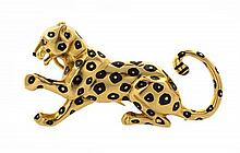 An 18 Karat Yellow Gold, Enamel and Emerald Panther Brooch, Cartier, 9.70 dwts.