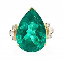 * A Platinum, Yellow Gold, Emerald and Diamond Ring, 9.10 dwts.