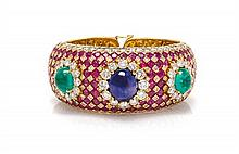 An 18 Karat Yellow Gold, Sapphire, Emerald, Ruby and Diamond Cuff Bracelet, Elan, 90.30 dwts.