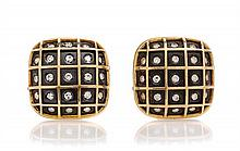 A Pair of 18 Karat Yellow Gold, Steel and Diamond Earclips, Gio Coneli, 11.40 dwts.