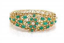 An 18 Karat Yellow Gold, Emerald and Diamond Bangle Bracelet, 31.90 dwts.