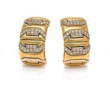A Pair of 18 Karat Yellow Gold and Diamond Earclips, 22.80 dwts.