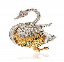 * A Two Tone 18 Karat Gold, Diamond, Emerald and Ruby Swan Brooch, 15.40 dwts.