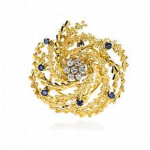 * An 18 Karat Yellow Gold, Diamond and Sapphire Brooch, 10.30 dwts.