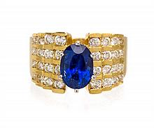 An 18 Karat Yellow Gold, Sapphire and Diamond Ring, 8.50 dwts.