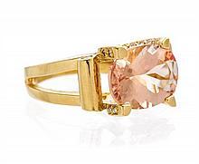 An 18 Karat Yellow Gold, Morganite and Diamond Ring, 9.00 dwts.