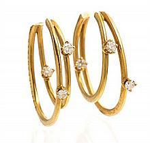 A Pair of 18 Karat Yellow Gold and Diamond Hoop Earrings, Tiffany & Co., Circa 1995, 2.90 dwts.