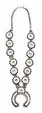 A Zuni Sun Face Kachina Squash Blossom Necklace Length 30 inches, naja 3 1/5 inches.